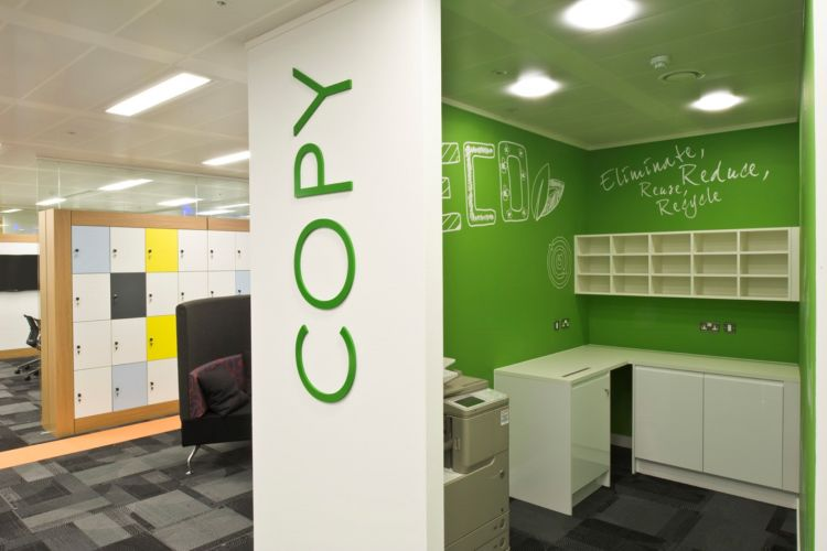 Playful photocopier area with green feature walls