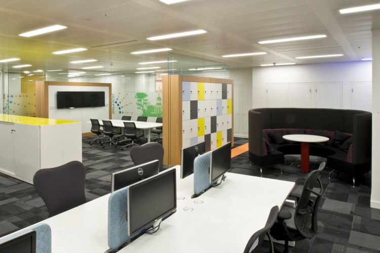 Workstations with storage cubicles, open meeting pods and ambient lighting / Designer offices