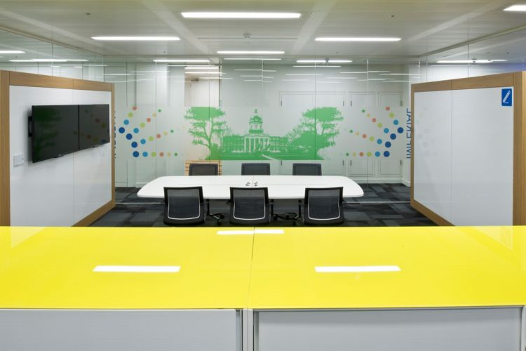 Colourful designer meeting room in office with glass walls and colourful decals