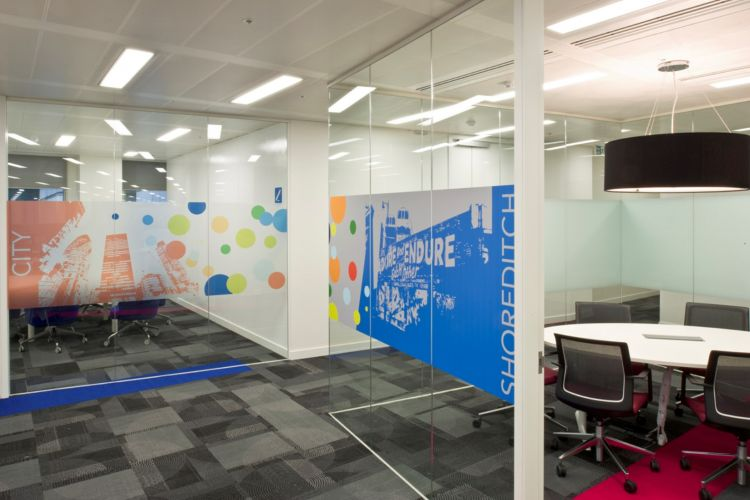Shoreditch themed meeting room with colourful glass decals / Designer offices