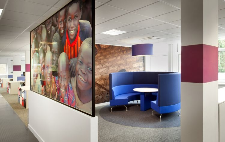 Semi-circular meeting pod surrounded by wall graphics in modern office fit out