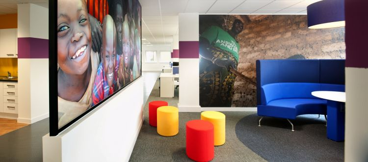 Coloured seating in open plan office layout