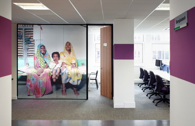 Large wall images theme each meeting room in this character-filled office
