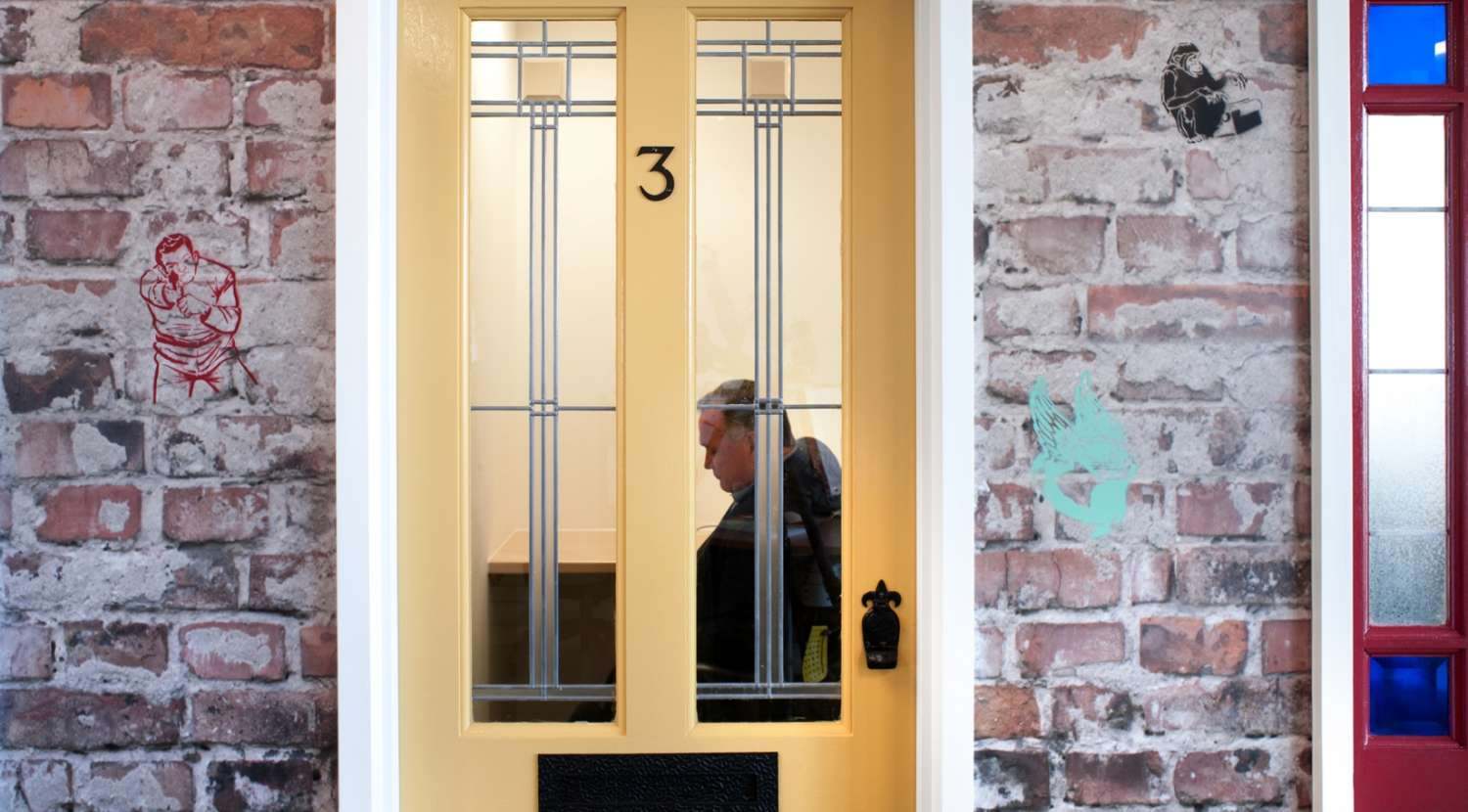 Residential front door as a meeting room entrance / Design and fit out by Morgan Lovell