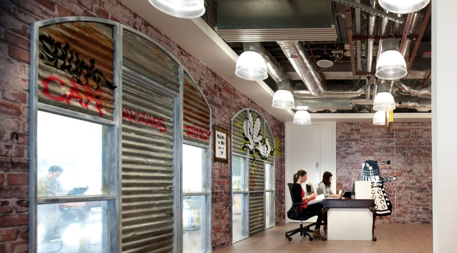 Railway arches provide character to this funky fit out