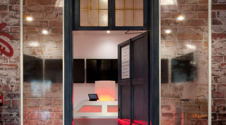 Open door inside the urban office design for Splunk in Paddington