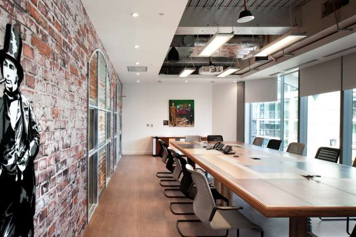 Graffiti and exposed bricks in the Splunk office boardroom