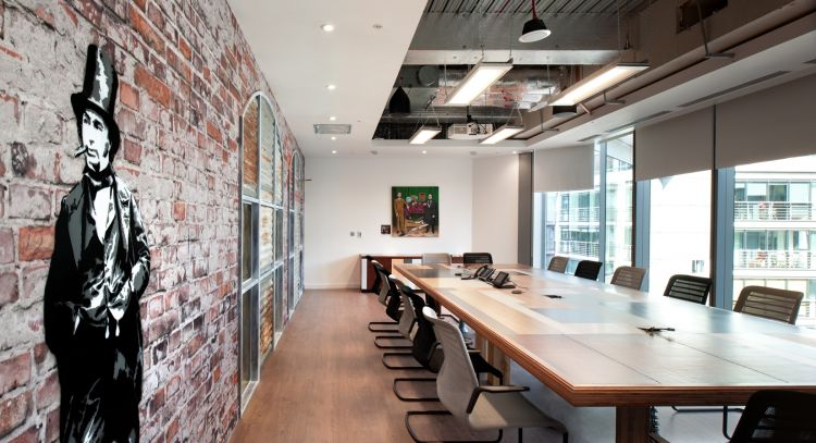 Graffiti and exposed bricks in the Splunk office boardroom