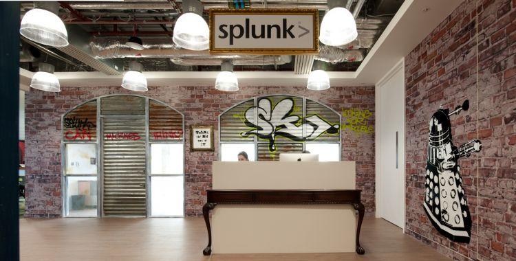 Graffiti and exposed bricks surround the reception at Splunk's Paddington office