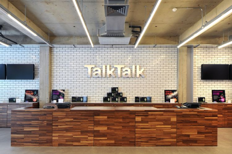 Talk Talk office reception; with white tiles and timber finishes