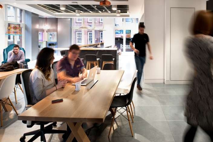 Staff working at relaxed wooden desk in London