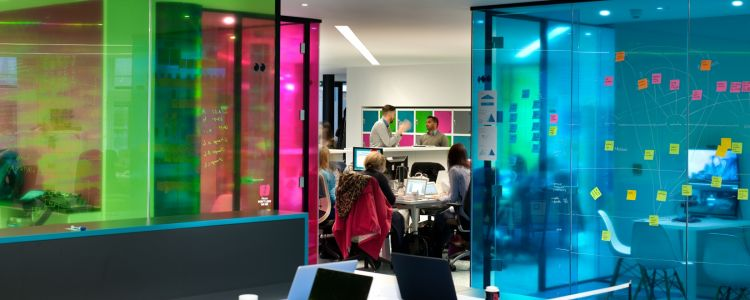 Brightly coloured panels break up this funky, relaxed open plan London office