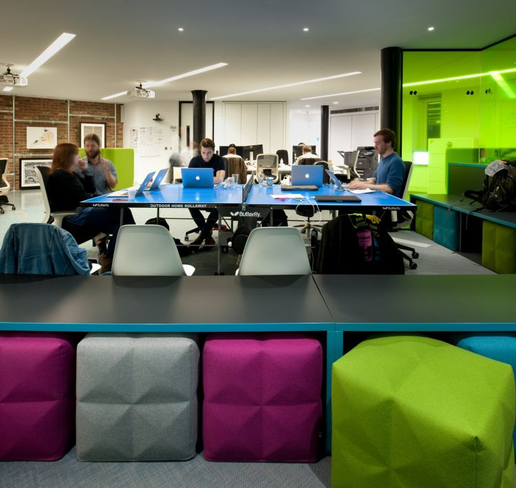 Staff working in bright funky london designer office space