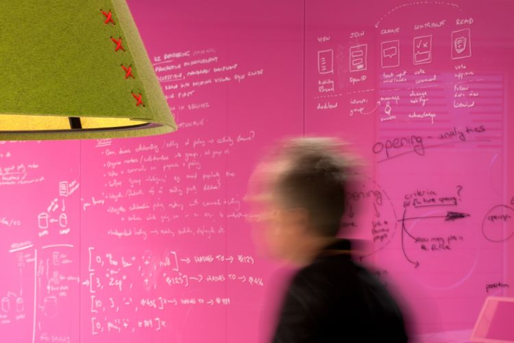 Pink write-on walls are a design feature in this London office