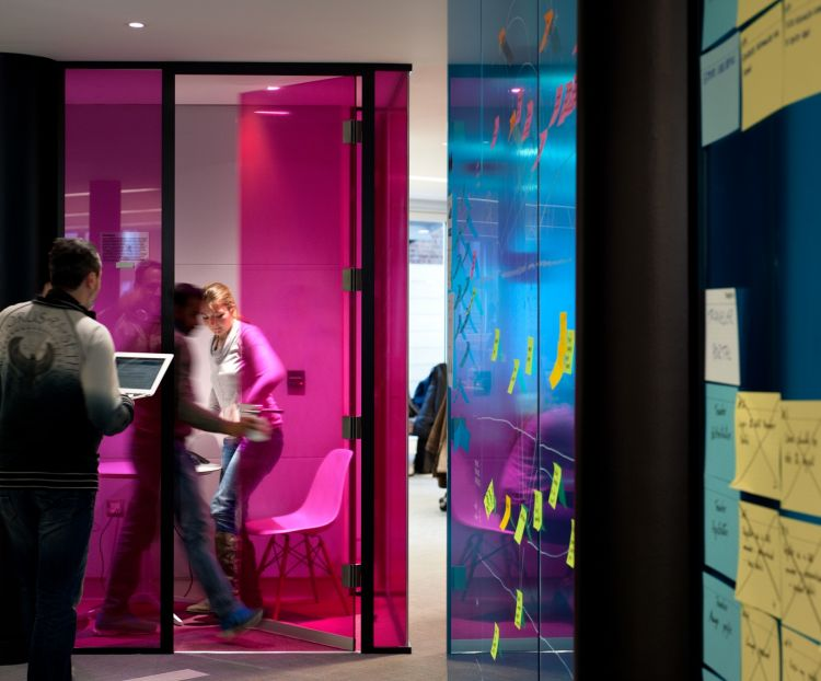 Funky coloured office space and post-it notes on the walls