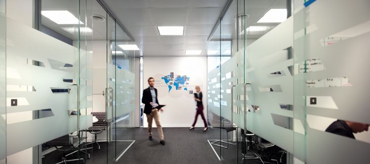 Glass meeting rooms open up this tech office design and fit out