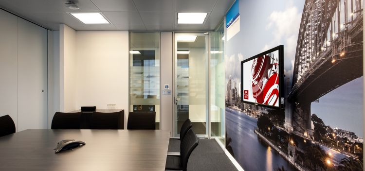 Sydney harbour bridge wall decal brightens up this meeting room in a designer office