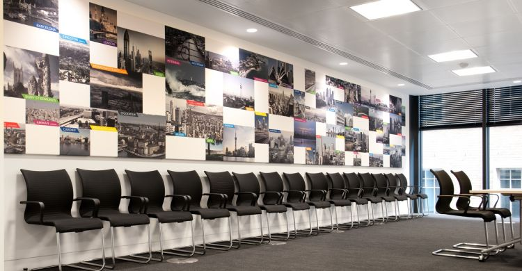 Collage of global cities in on the wall in london meeting room