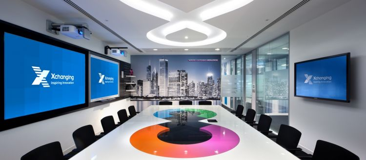 Boardroom table with large screens in designer office fit out