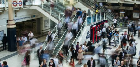 People commuting through Liverpool Street Station