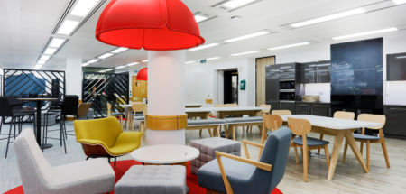 Red chairs and hanging feature light fitting | Alan Turing Office Design & Fit Out